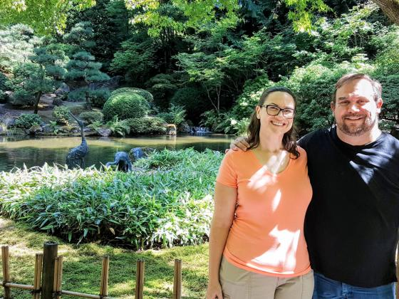 An image of technical writer Josh Seale and his wife at a botanical garden.
